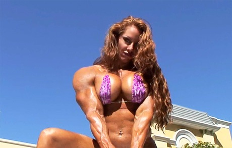 Busty Muscular Mistress posing and flexing her biceps